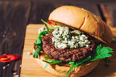 Fresh burger with blue cheese and arugula