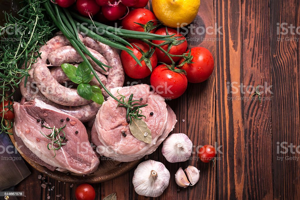 Fresh butcher cut meat assortment garnished with fresh rosemary stock photo