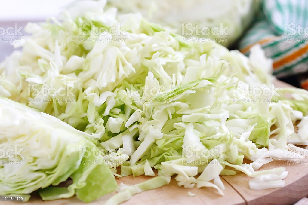 Fresh cabbage and other vegetables on the table stock photo