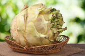 fresh cabbage kohlrabi in a wicker basket on dark wooden