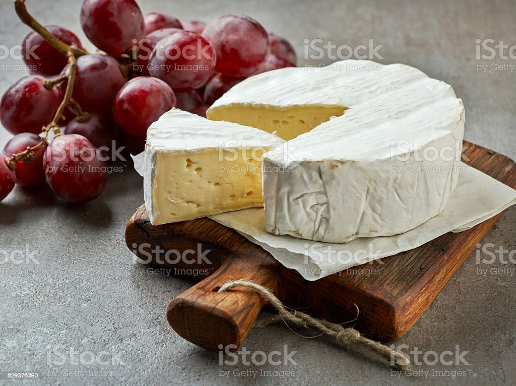 fresh camembert cheese stock photo