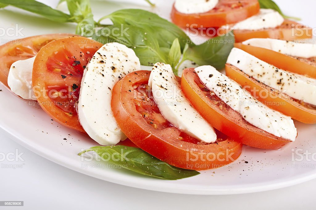 Fresh Caprese salad of mozzarella, tomato and basil stock photo