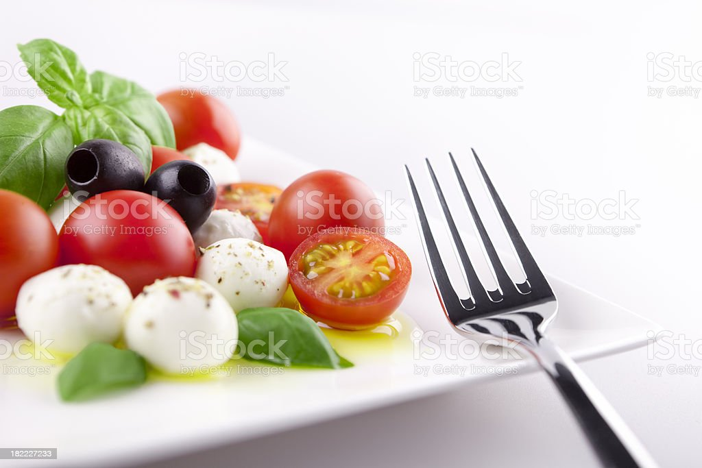 Fresh Caprese salad on a table in bright light stock photo