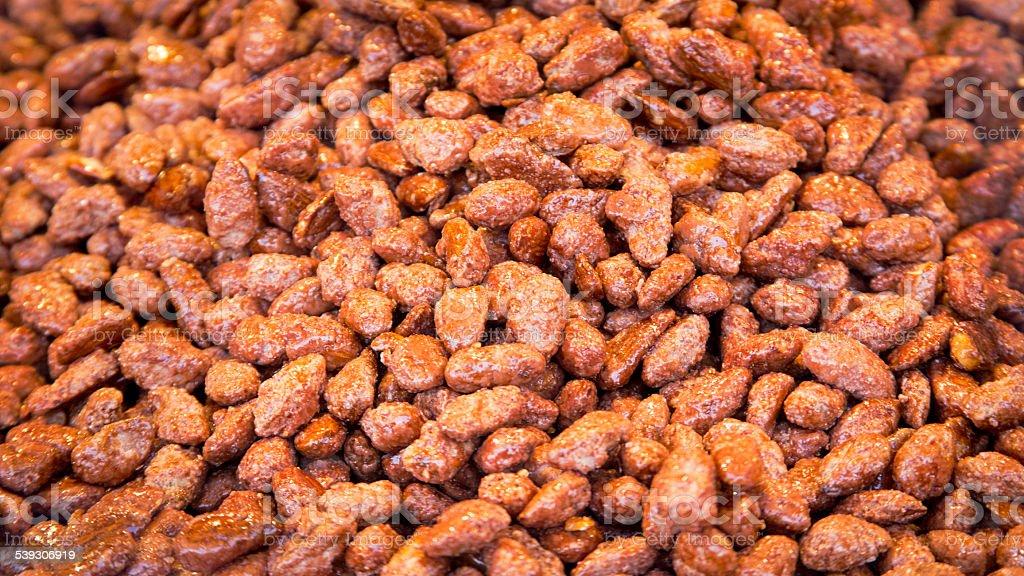 fresh caramelized almond background stock photo
