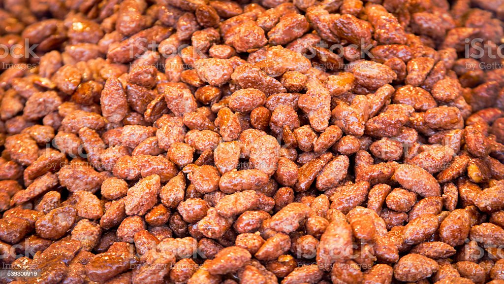 fresh caramelized almond background stock photo
