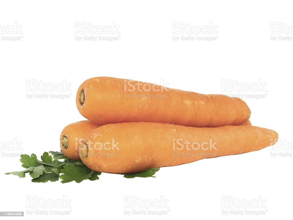 Fresh carrot and parsley on white.Isolated. royalty-free stock photo