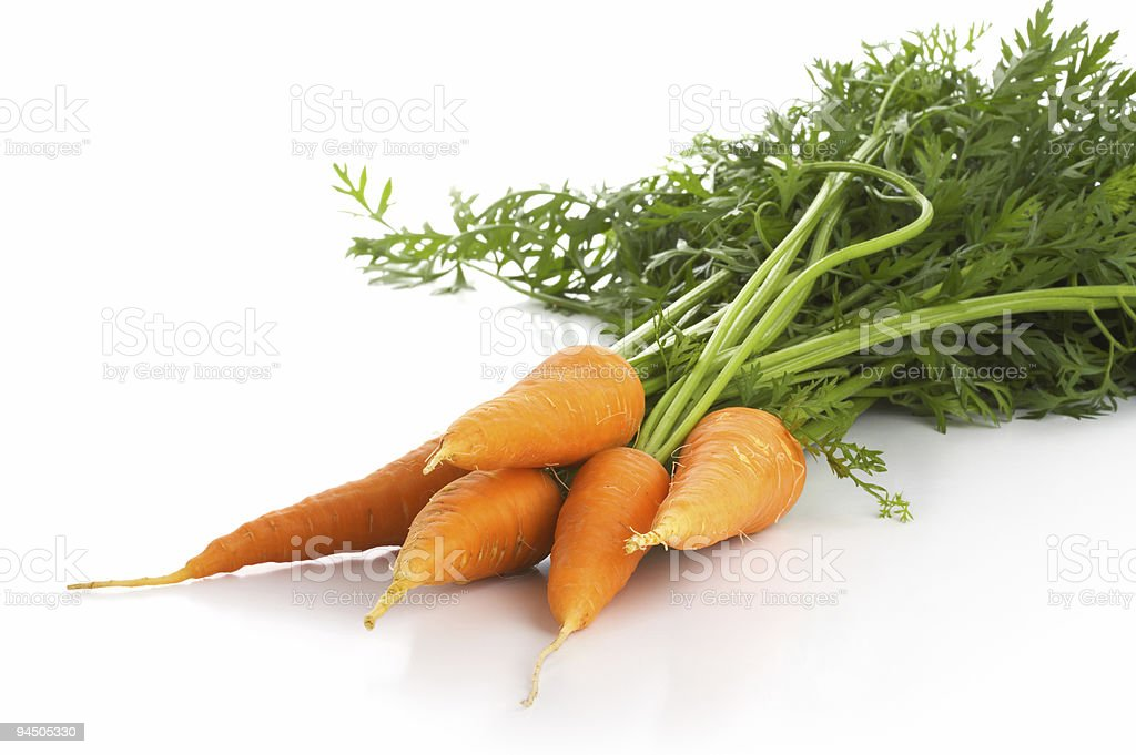 Fresh carrot isolated over white royalty-free stock photo