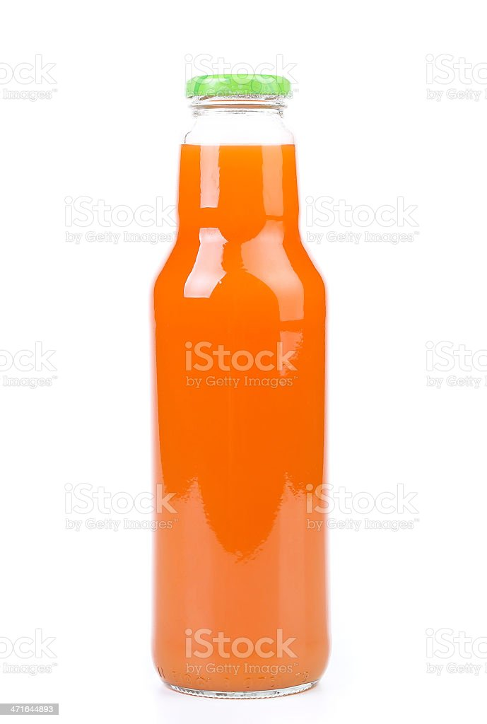 Fresh carrot juice in a bottle royalty-free stock photo