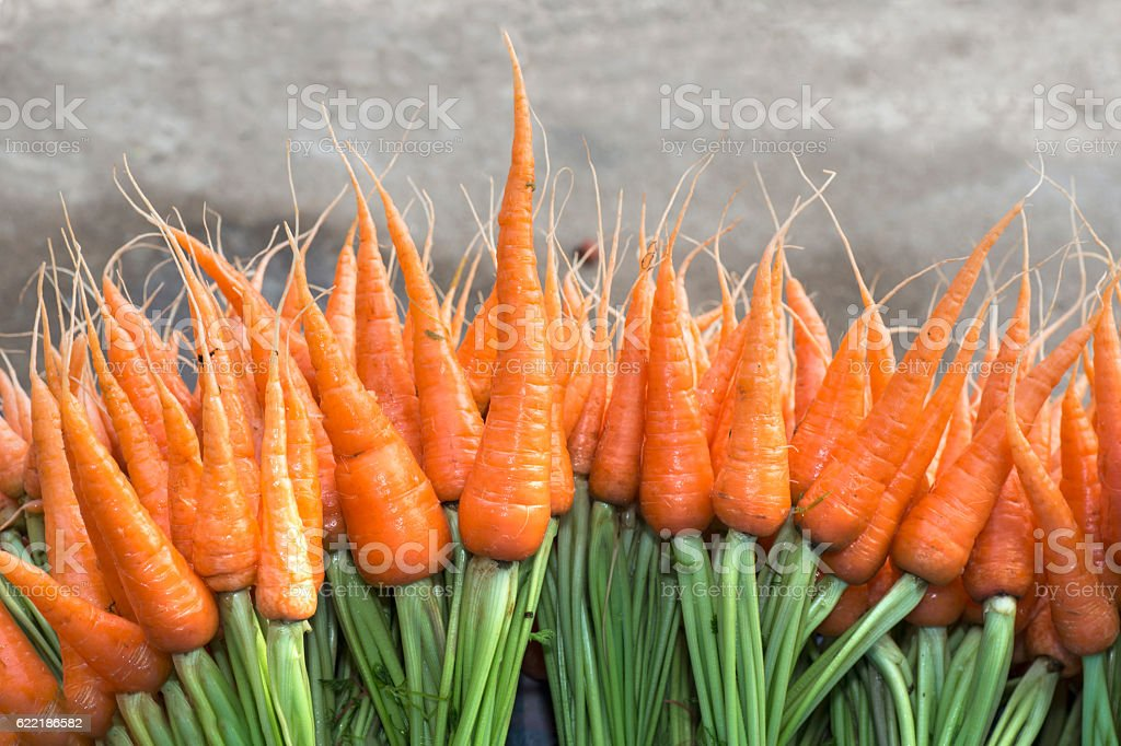Fresh carrots for sale at a farmer's market stock photo