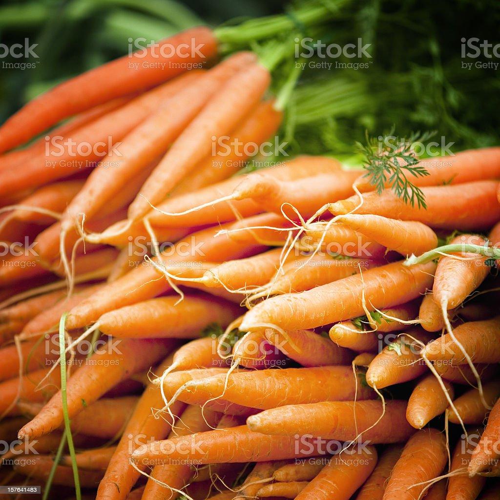 Fresh carrots on marketplace royalty-free stock photo
