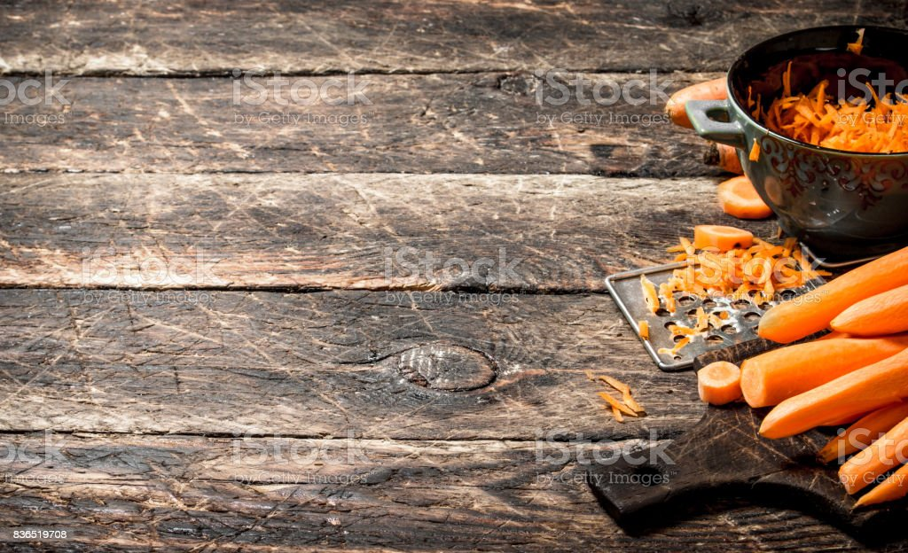 Fresh carrots .On the old wooden table. stock photo