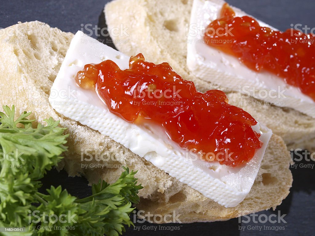 Fresh cheese & tomato marmalade tapas royalty-free stock photo