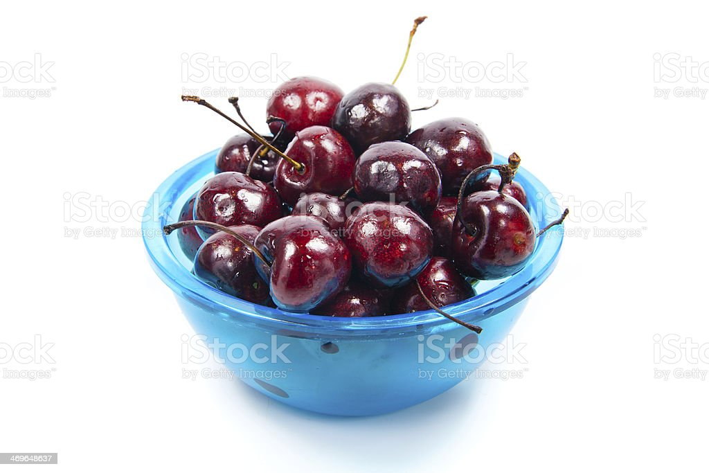 Fresh cherries in bowl isolated on white royalty-free stock photo