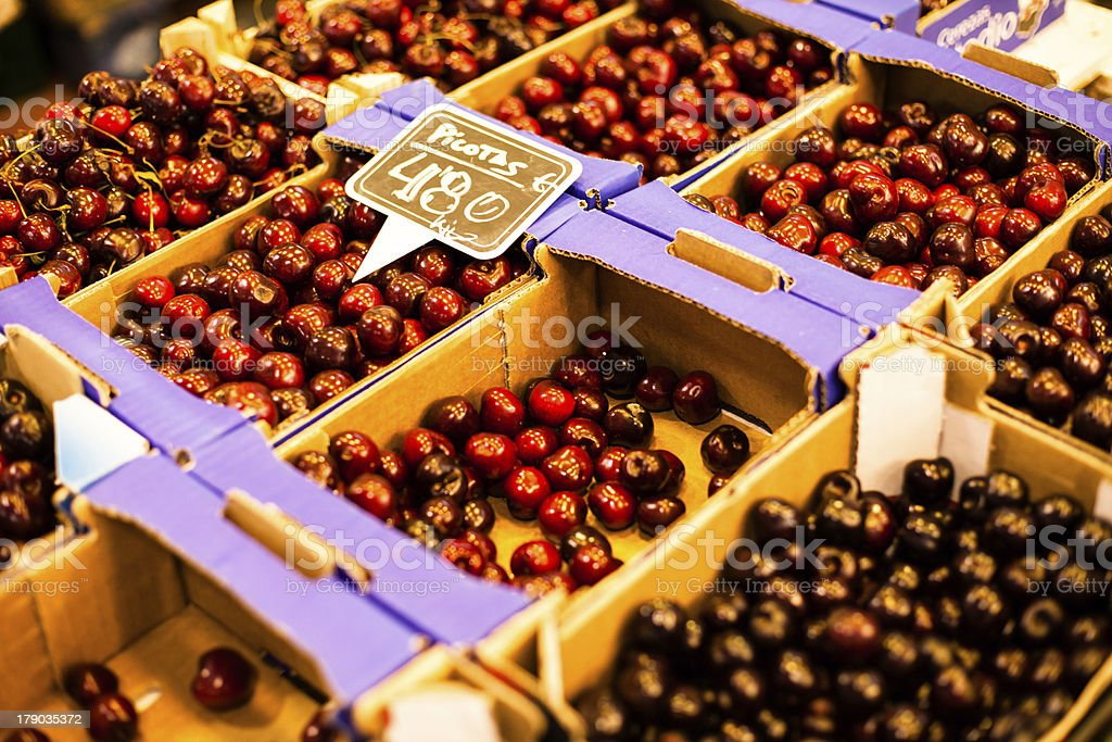 Fresh cherries in box at a farmers market royalty-free stock photo