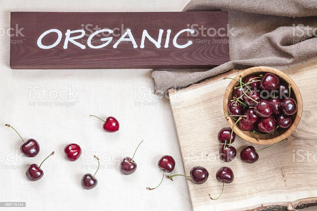 Fresh Cherries On The Wooden Boat stock photo