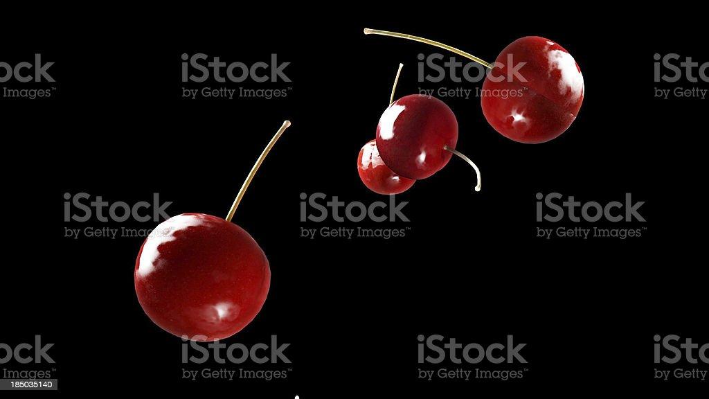 fresh cherry falling down black royalty-free stock photo
