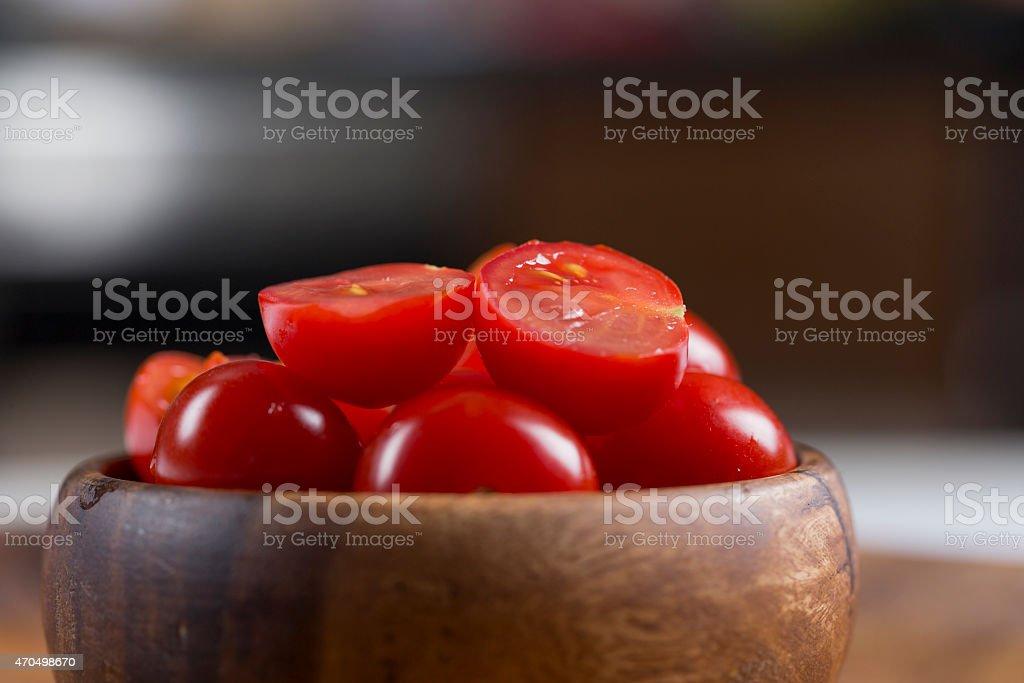 Fresh Cherry tomato on wooden bowl stock photo