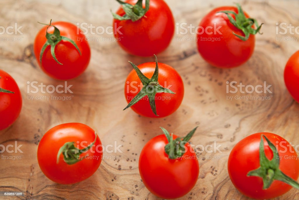 Fresh cherry tomatoes on a wooden background. Top view with stock photo