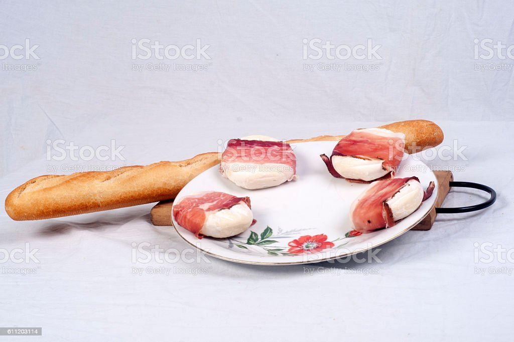 Fresh chese and baguette on display stock photo