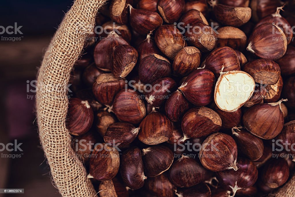 fresh chestnuts in sack bag stock photo