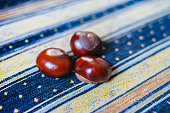 Fresh chestnuts on textile background