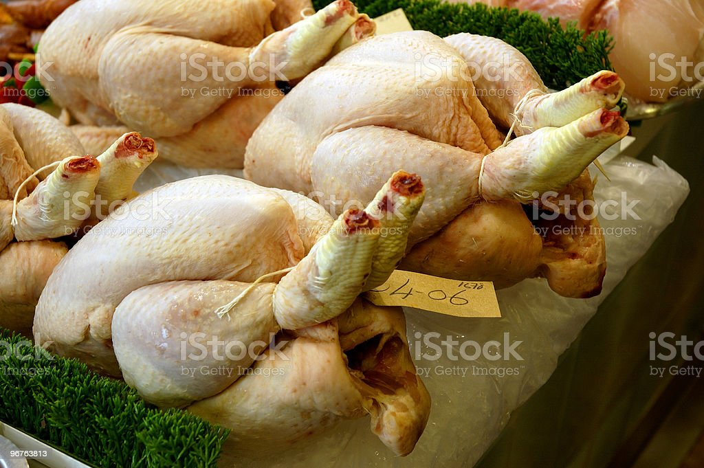 Fresh chicken at a market, waiting to be sold stock photo