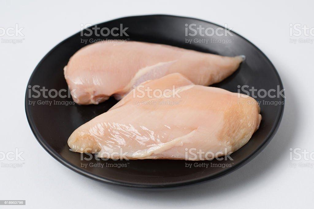 Fresh chicken breast fillets on black dish stock photo
