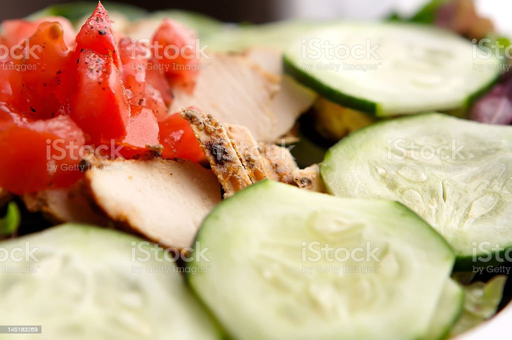Fresh chicken salad with cucumber and chopped tomatoes stock photo