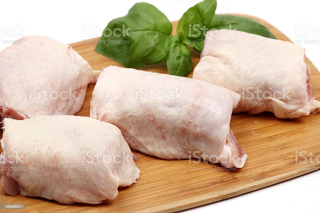 Fresh chicken thighs stock photo