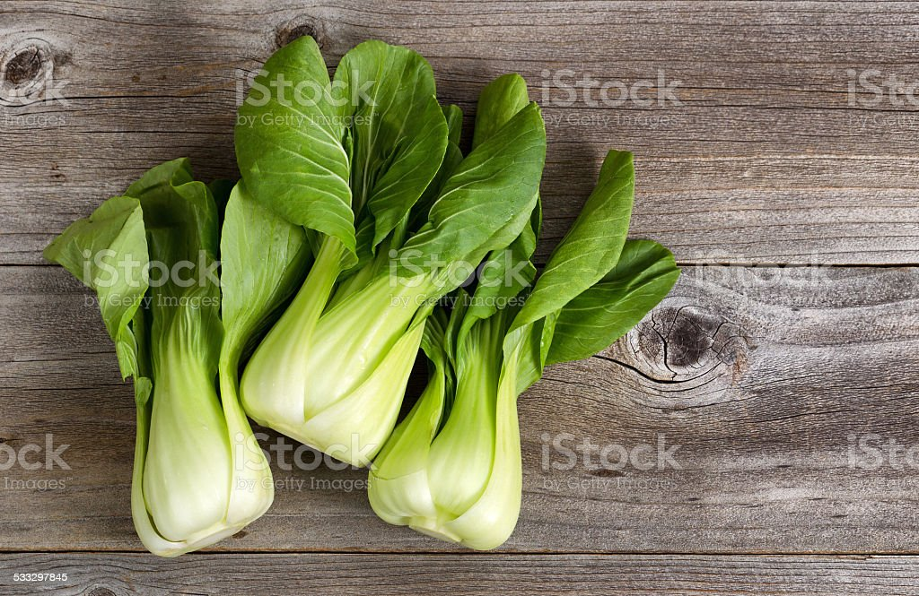 Fresh Chinese Cabbage on Rustic Wood stock photo