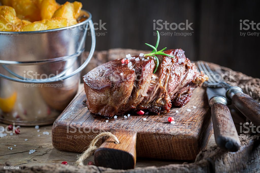 Fresh chips and steak with salt and rosemary stock photo