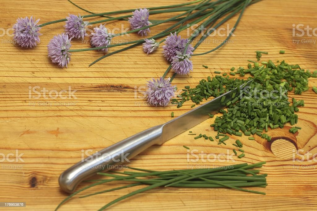 Fresh chives on wooden board stock photo