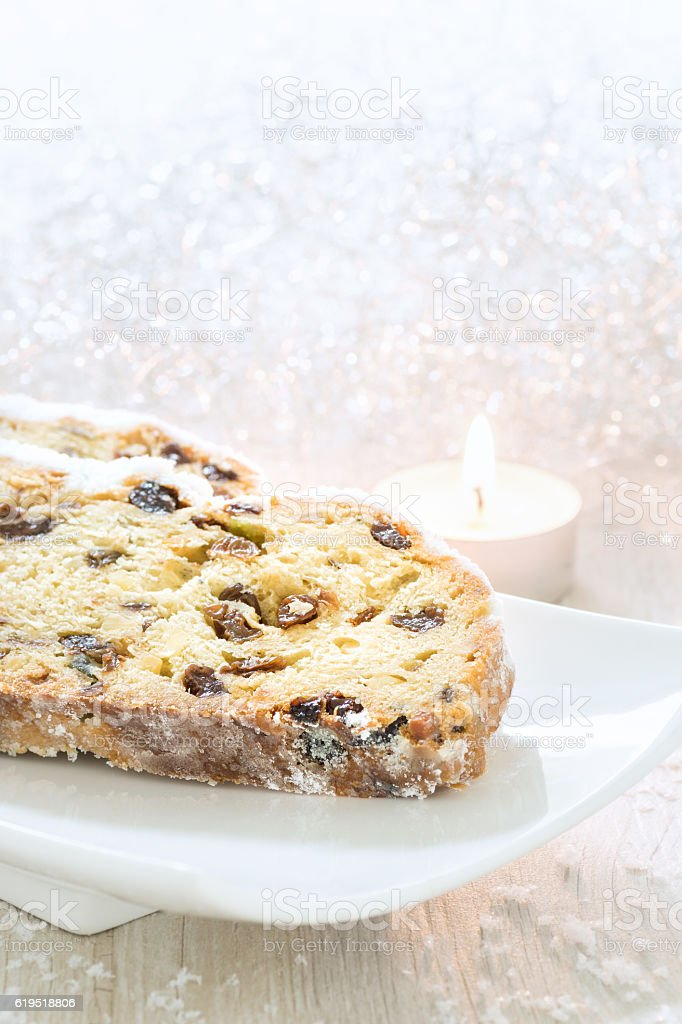 Fresh Christmas Stollen on a white plate. stock photo
