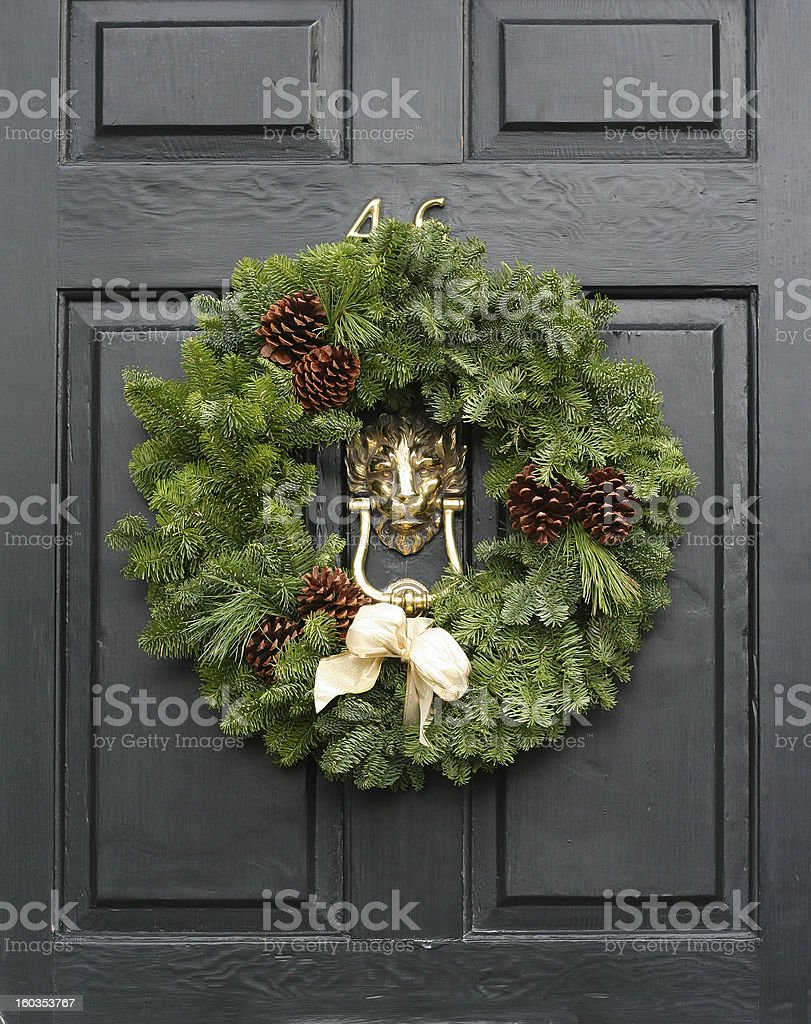 Fresh Christmas wreath on a door royalty-free stock photo