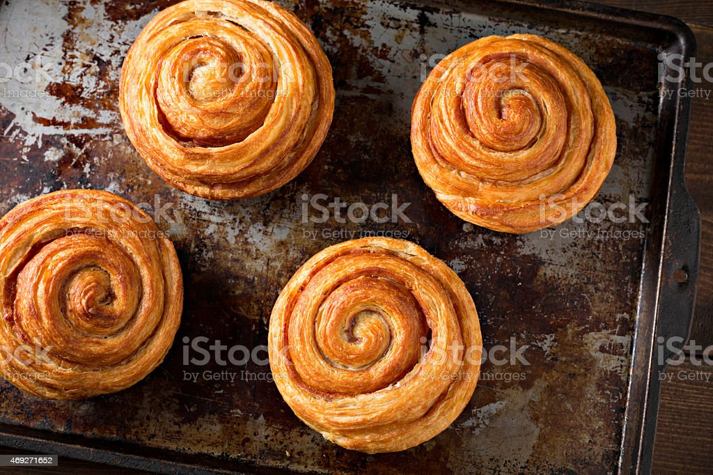 Fresh Cinnamon Butter Rolls On A grungy Old Tray stock photo