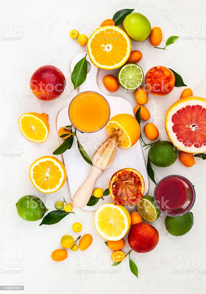 Fresh citrus fruits cut in half on a white background stock photo