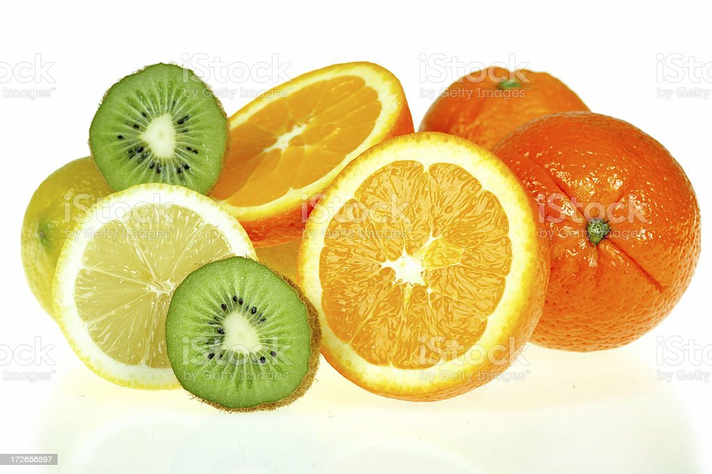 Fresh citrus fruits, most of them sliced in half royalty-free stock photo