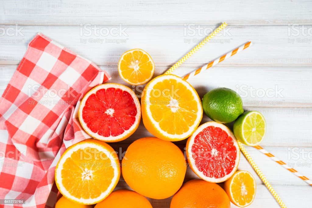 Fresh citrus fruits on a brown wooden table stock photo