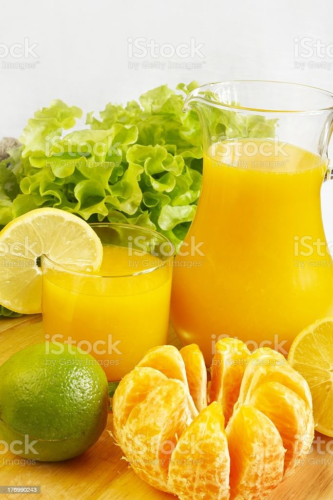 Fresh citrus juice in glass and jug royalty-free stock photo