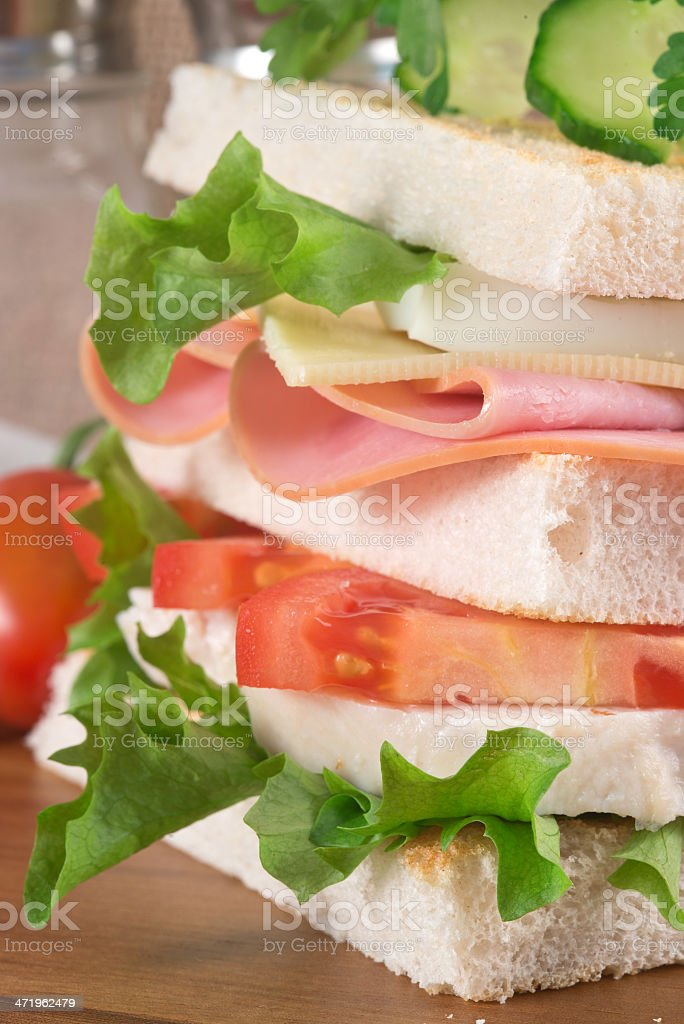 Fresh club sandwich in rustic kitchen setting royalty-free stock photo