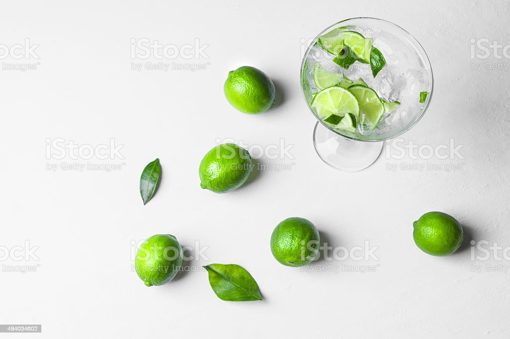 Fresh cocktail with lime slices stock photo