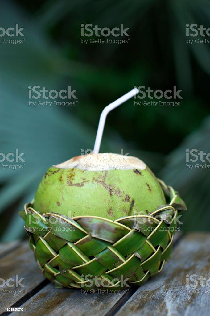 Fresh Coco Gelado Drinking Coconut in Woven Basket royalty-free stock photo