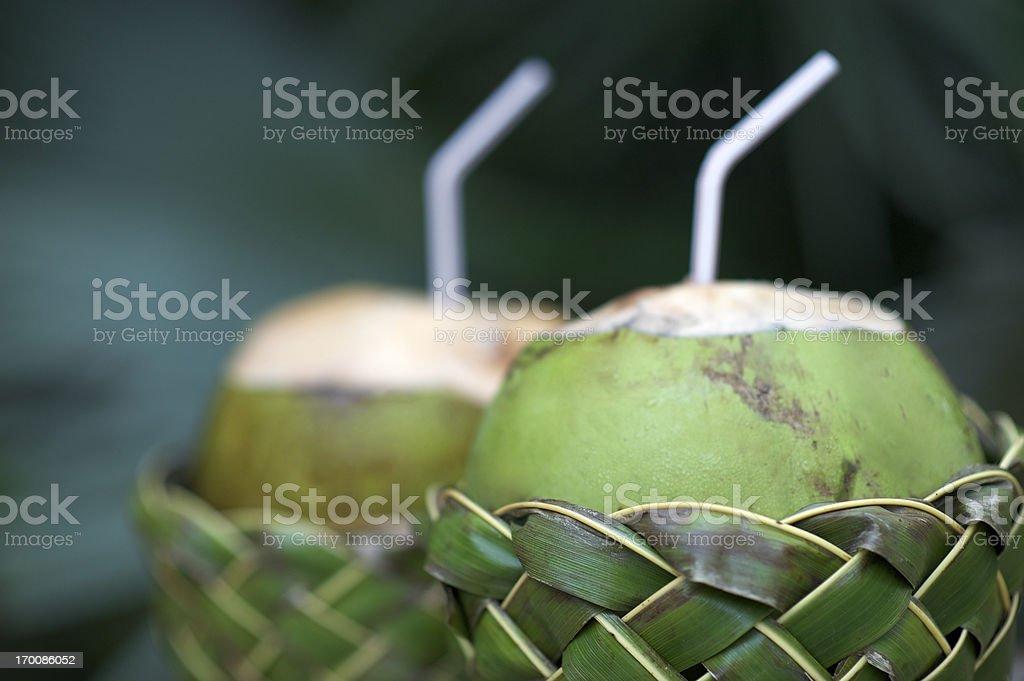 Fresh Coco Gelado Drinking Coconuts in Woven Basket stock photo