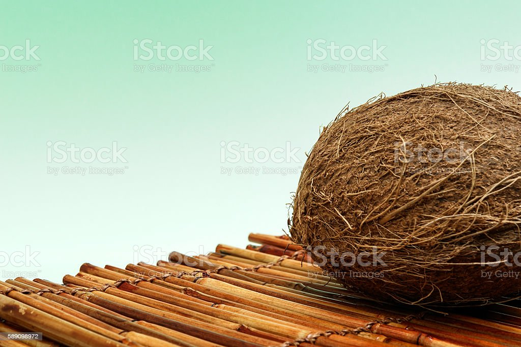 Fresh Coconut and bamboo isolated on green background stock photo