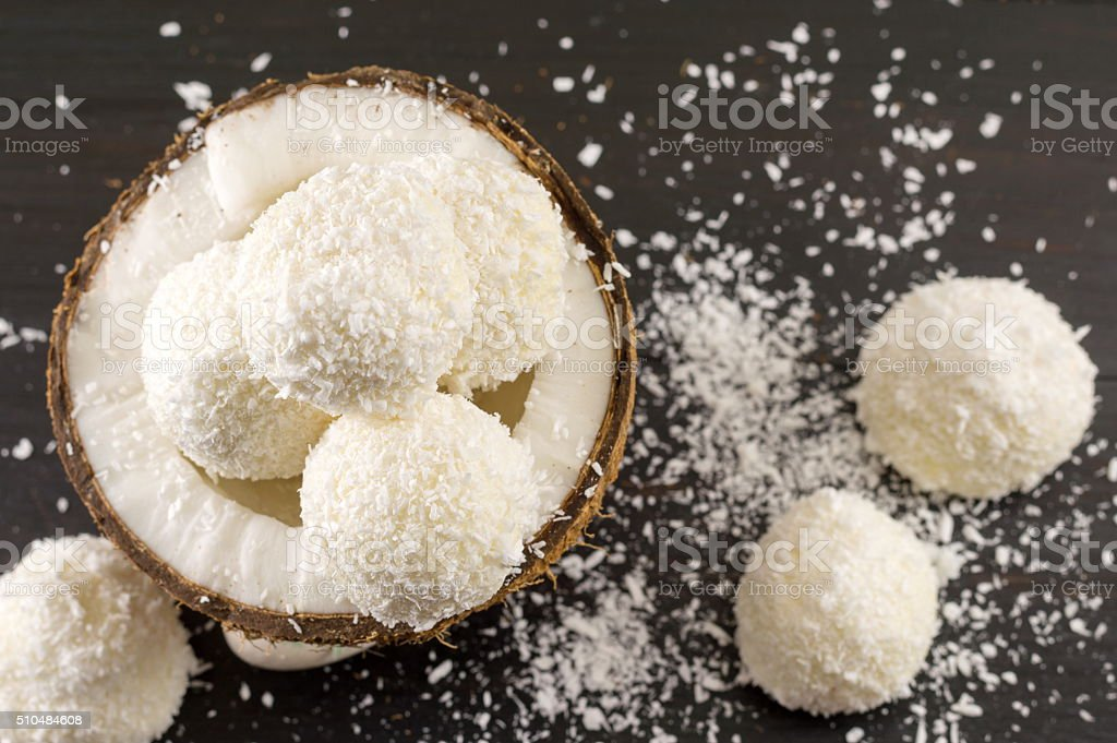 Fresh coconut and coconut cookies on dark background stock photo