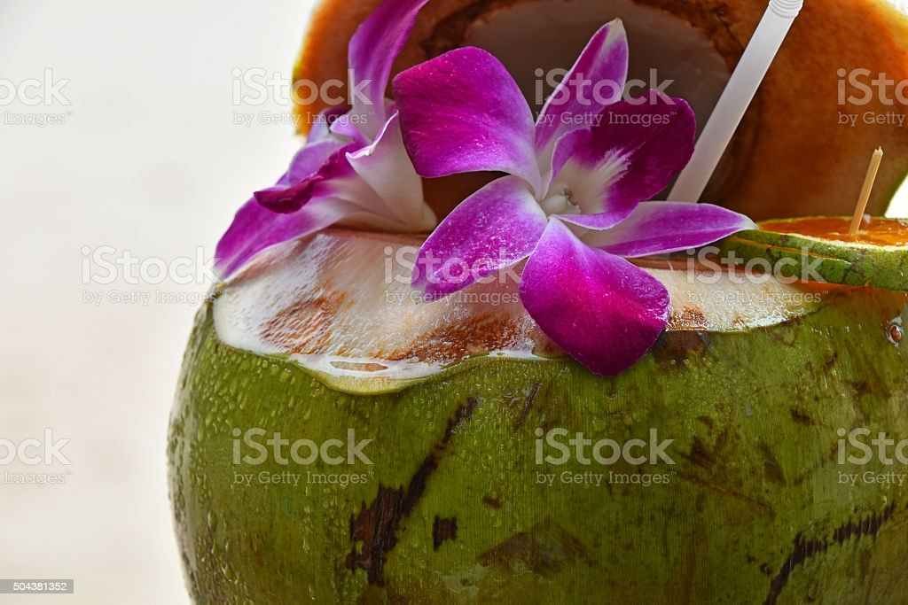 Fresh coconut milk juice decorated with flowers royalty-free stock photo