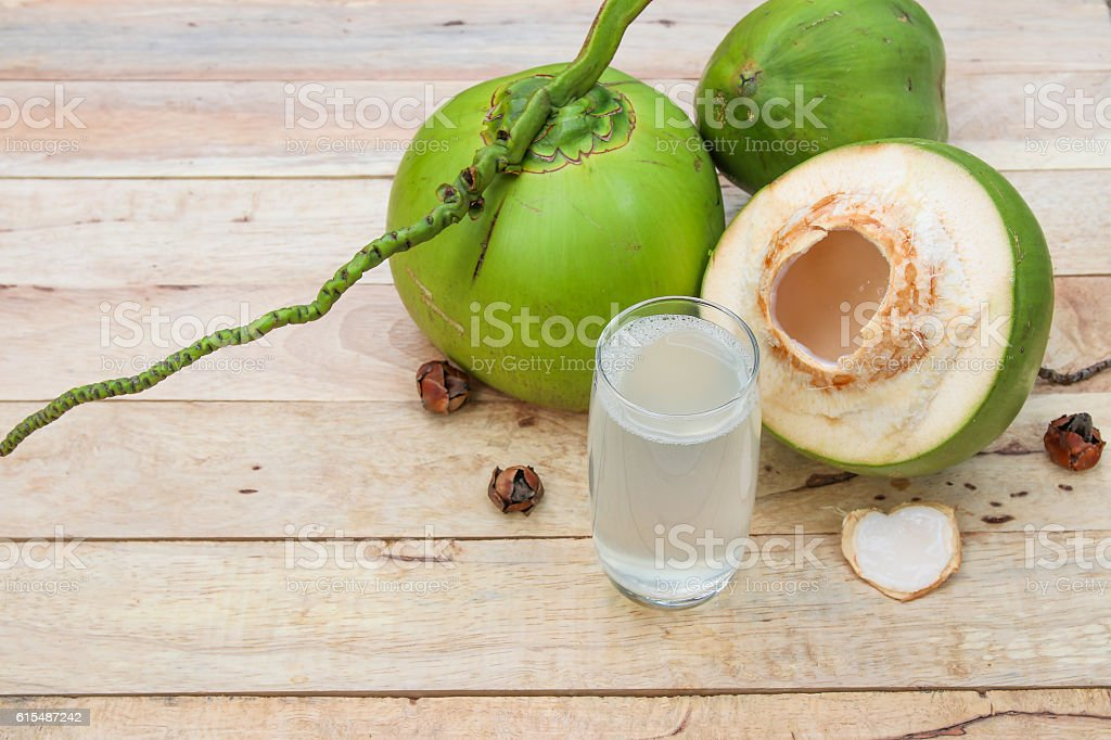 Fresh Coconut Water Drink  on wooden  background stock photo