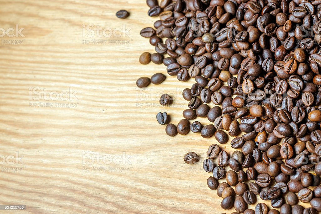 Fresh coffee beans on a wooden background stock photo