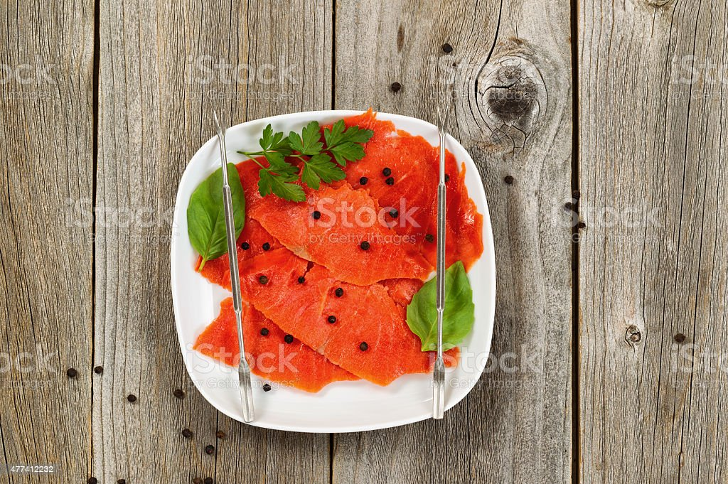 Fresh Cold smoked red salmon on plate stock photo