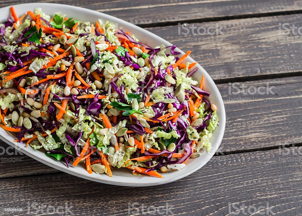 Fresh Cole slaw with pumpkin, flax, sesame seeds stock photo